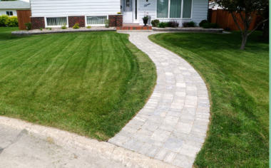 Curving brick walkway to house