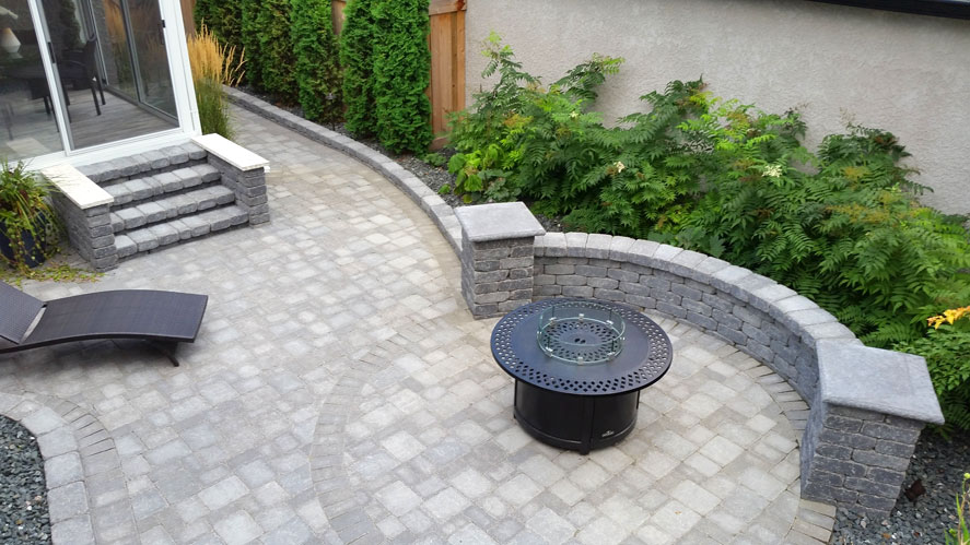Brick steps bring you from the back patio door over to the fire pit on Brock Street