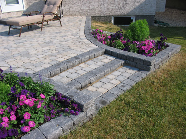 Roman Stack patio steps and planters on Brian Monkman Bay