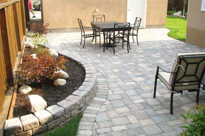 Intimate Roman paver patio on Mulvey Ave