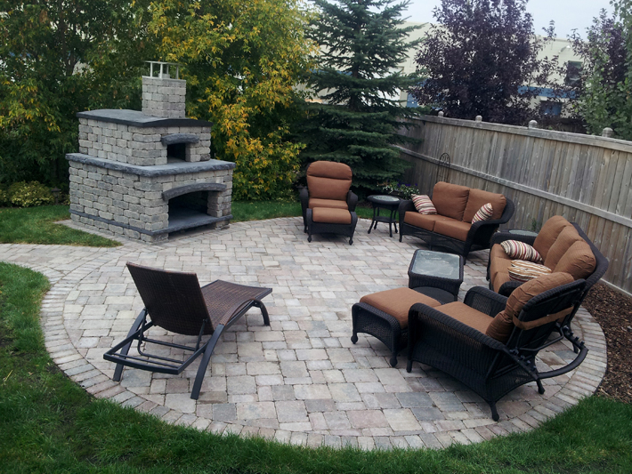 Outdoor living room with pizza oven on Tangle Ridge Crescent