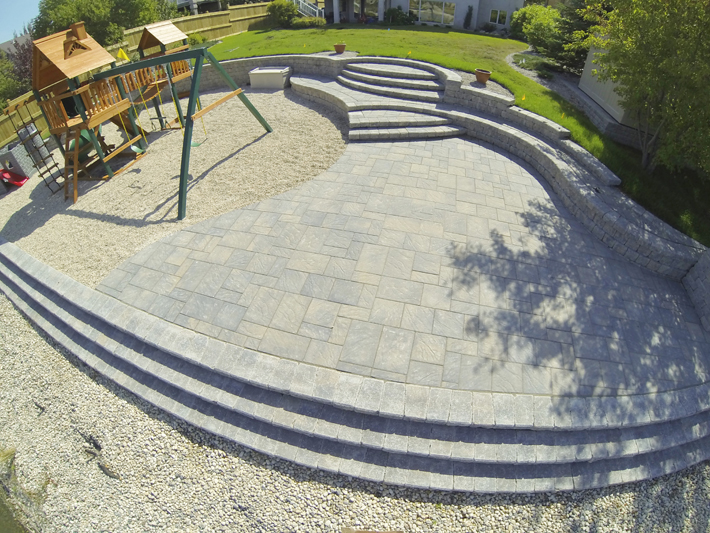 Play structure and patio using Navarro pavers with Roman Pisa walls and steps on Lindenshore Drive