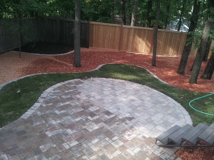 A back yard transformed with classic looking brick work on Sanders Bay