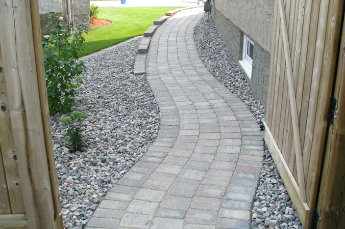 Roman paver stone pathway along side of house on Aspen Cove