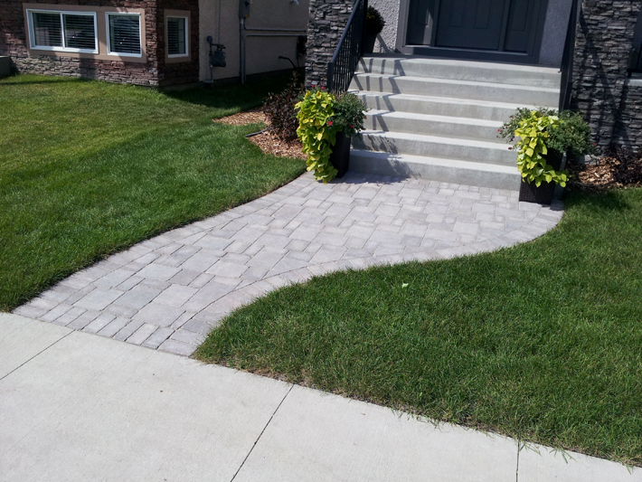 Simple curving Roman paver walkway on Bridgeland Dr North