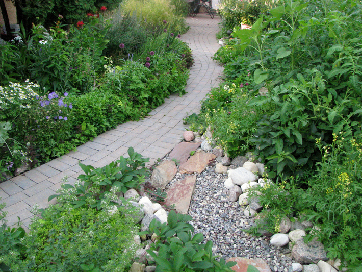 Holland paver stone pathway through garden on Nicollet Ave