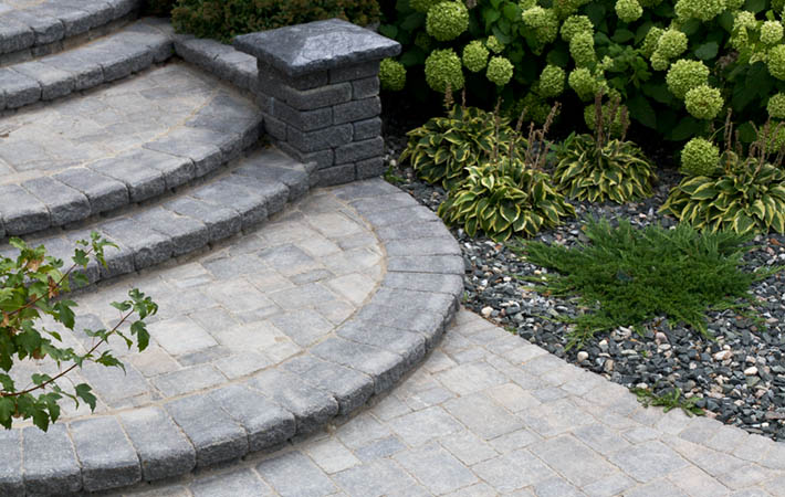 Concrete paver brick steps from garden